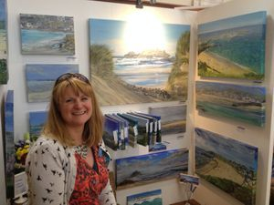 Cornish Artist Lindsey Keates painting in her garden studio
