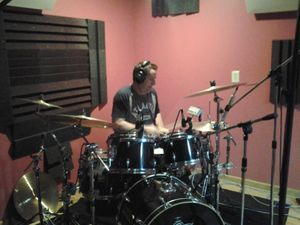 Jim Riley of Rascal Flatts plays on a Drum Tracks Online project
