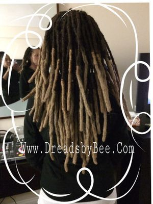 Instantloc Dread Extensions method combined with reattaching natural dreadlocks.