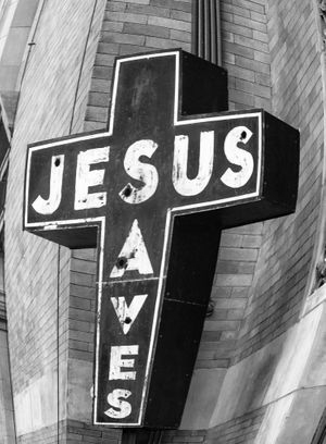 Jesus Saves sign on a wall.