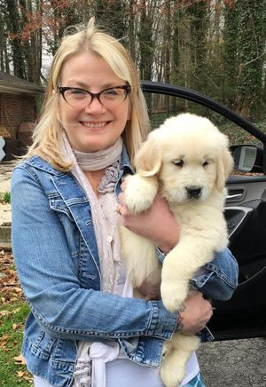 New puppy with her new owner...to be trained as a service dog.