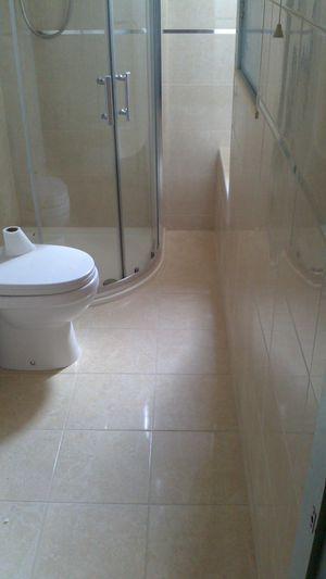 Bathroom fitted and tiled complete