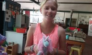 Jade loves her knitted unicorn