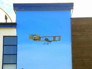 flying mural plane street art