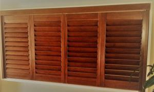 stain timber shutters in a wall internally