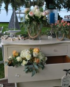 Vintage dresser with peach and white flowers