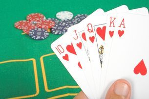 "image of gambling with playing cards at a casino table - heading "" don;t gamble with cheap skip bin hire prices"""