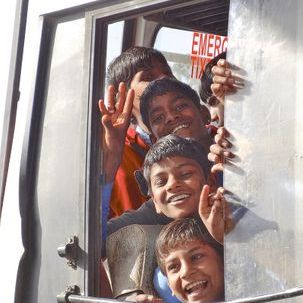 "src=""australian womens travel.jpg alt=womens tours,boys looking out of bus window , India"