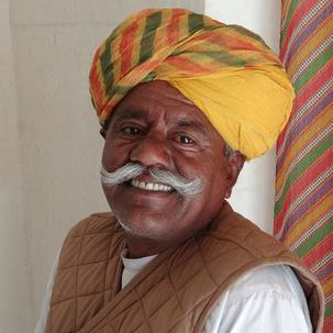 "src=""australian womens travel.jpg alt=rajasthani man with turban and big smile , India"