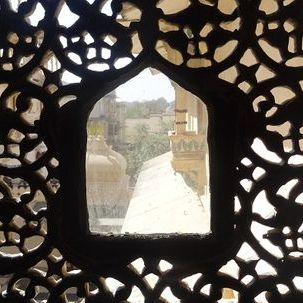 "src=""australian womens travel.jpg alt=womens tours, view though carved window, amber fort, jaipur , India"