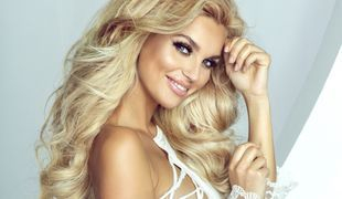 Beautiful blond woman touching her long hair