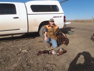 Lisa and Cora with pheasants in South Dakota!