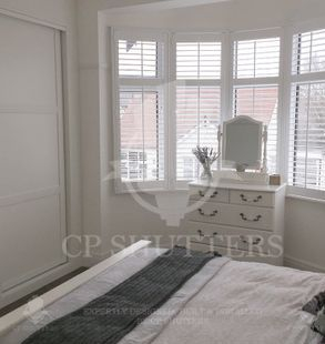 A gorgeous bedroom in the heart of Essex, fitted with window shutters by CP Shutters.