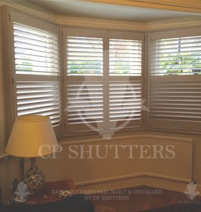 Another beautiful bay window, dressed with our bespoke interior plantation shutters, installed by CP shutters