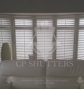 Shutters in havering by the sofa