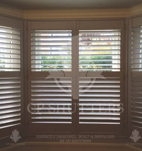Interior wooden shutters made by CP Shutters in Essex