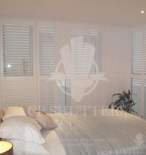 Many bedrooms look amazing with our plantation shutters, like these, designed and installed by CP Shutters
