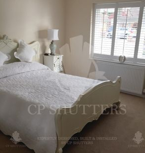 A beautiful bedroom in the heart of Essex, dressed with our customer plantation window shutters
