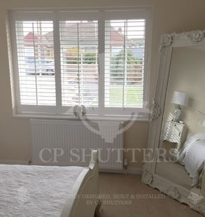 Quality wooden window shutters, installed inthis shabby chic bedroom, situated in Shenfield, Essex, designed and installed by CP Shutters.