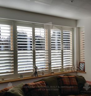 These bespoke interior wooden window shutters looked amazing in this window, Essex.