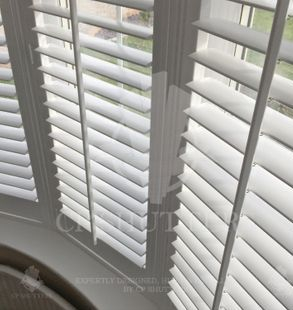 White wood window shutters, installed in Essex by CP Shutters.