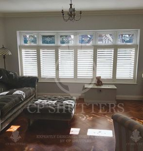 White plantation window shutters, installed in Essex by CP Shutters