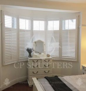 custom plantation shutters in bedroom