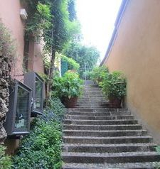 "ravel, stairway to piazza, bellagio, lake como, italy"">"