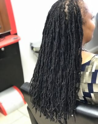 Braids by Bee starts micro size dreadlock dread extensions with her permanent dreadlock extensions.