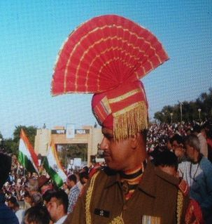 "src=""australian womens travel.jpg alt=womens travel,indian soldier with fanned hat, wagah border , India"