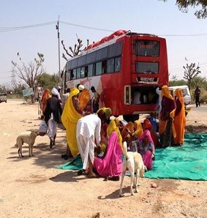 "src=""australian womens travel.jpg alt=womens travel,locals on a bus tour stopping for resfreshment, rajasthan  , India"