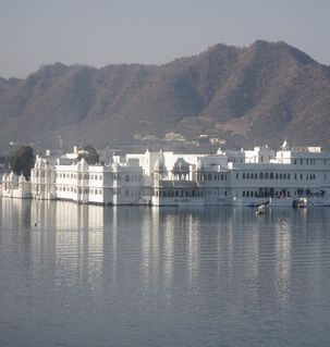 "src=""australian womens travel.jpg alt=womens travel,lake palace hotel in the distance, udaipur , India"