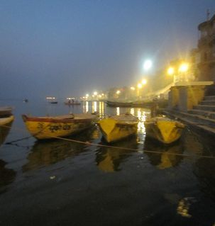 "src=""australian womens travel.jpg alt=womens travel,boats and lights at dawn on the ganges, varanasi , India"