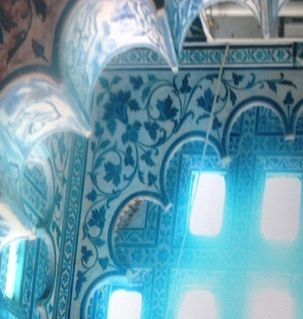 "src=""australian womens travel.jpg alt=womens travel,sun shining though blue glass panels, city palace, udaipur , India"