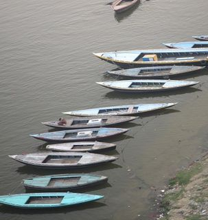 "src=""australian womens travel.jpg alt=womens travel, wooden boats in a row on the ganges, varanasi, India"