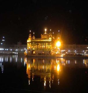 "src=""australian womens travel.jpg alt=womens travel,golden temple glowing at night, amritsar , India"