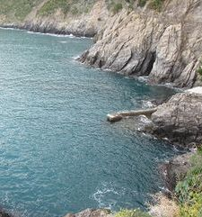 "ours.jpg alt=womens travel, clear blue sea and rugged cliffs, cinque terre, italy"">"