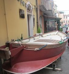 "ours.jpg alt=womens travel, fishing boat on street, cinque terre, italy"">"