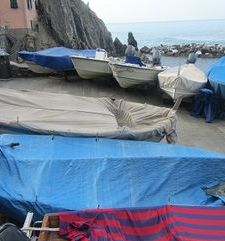 "ours.jpg alt=womens travel, covered fishing boats manarola, cinque terre, italy"">"