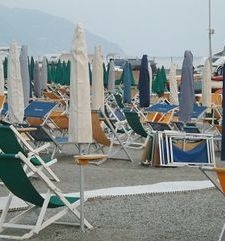 "ours.jpg alt=womens travel, beach umbrellas closed fpr the night, monterosso al mare cinque terre, italy"">"