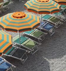 "ours.jpg alt=womens travel, striped beach umbrellas, monterosso al mare,cinque terre, italy"">"