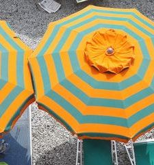 "ours.jpg alt=womens travel, striped beach umbrella detail, monterosso al mare,, cinque terre, italy"">"