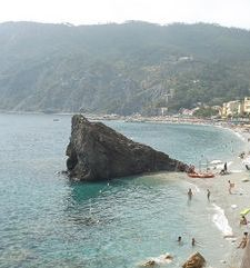 "ours.jpg alt=womens travel, rugged rock in the sea,monterosso al mare italy"">"