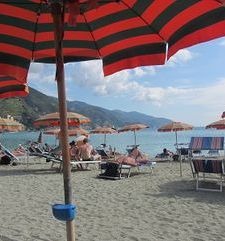 "ours.jpg alt=womens travel, relaxing on the beach under an umbrella, monterosso al mare, cinque terre, italy"">"