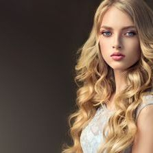 Pretty young blonde woman with hair extensions