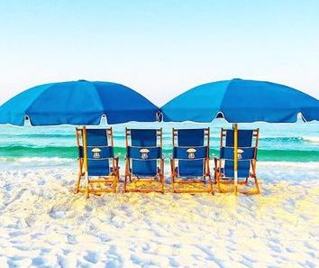 four chairs and two umbrellas