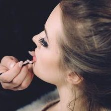 Woman getting a professional makeup service
