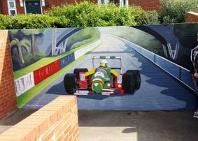 racing car kemsley exterior outside mural hand painted play ground colourful track
