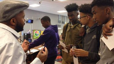 Donney Rose shares the power of poetry with three young black men at Donaldsonville High School.