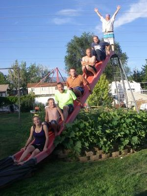 free standing Red 22ft slide with people